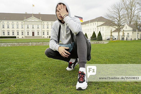 Young emotive youngster man in front of Bellevue Palace  in Berlin  Germany