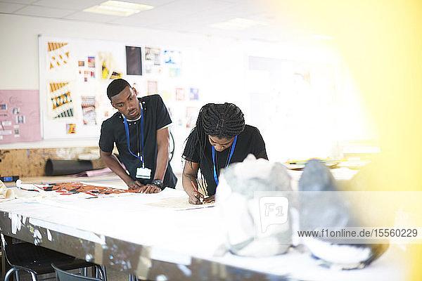 Art students working in art studio