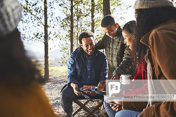 Family eating at campsite