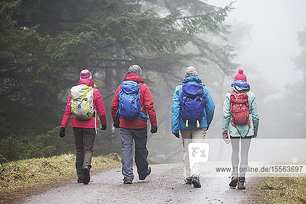 Family hiking in rain