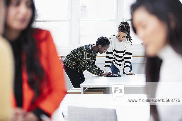 Businesswomen working in new office
