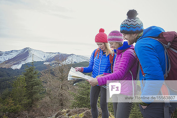 Friends with map hiking