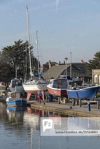 Bude,  North Cornwall,  England,  UK. February 2019. Bude Canal with boats on the wharf,  out of the water for winter.