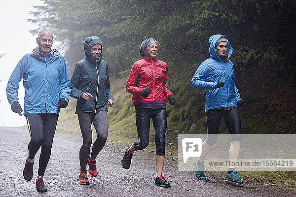 Family jogging in rain