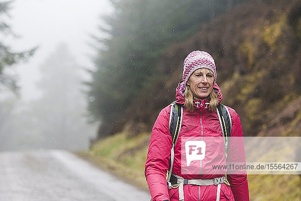Woman hiking in rain