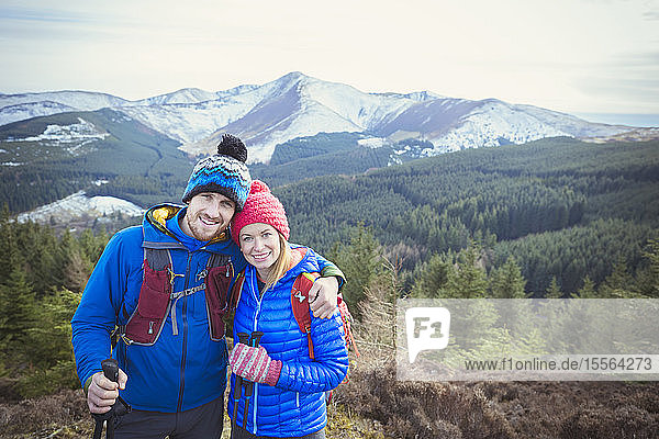 Happy couple hiking on mountaintop