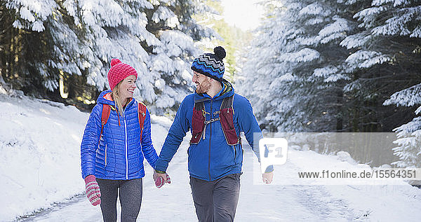 Couple hiking in snow
