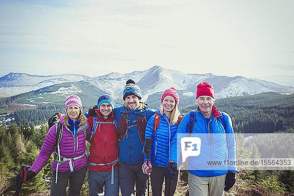 Portrait happy family mountain hiking