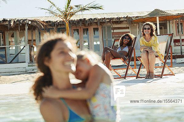 Happy women on sunny beach