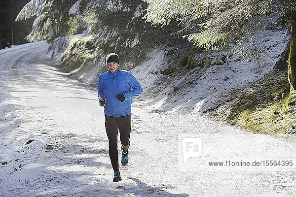Man jogging in snow