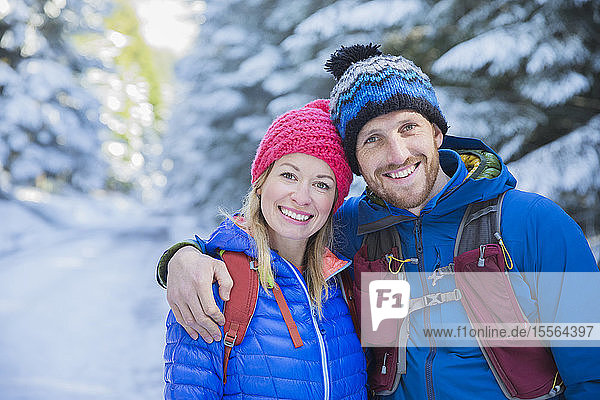 Portrait couple hiking in snow