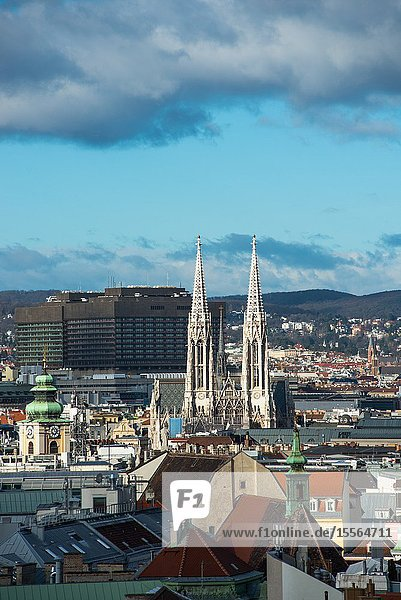 Vienna city skyline with the twin spires of the Votive Church seen from the top of St. Stephens Cathedral (Stephansdom) North tower. Austria.
