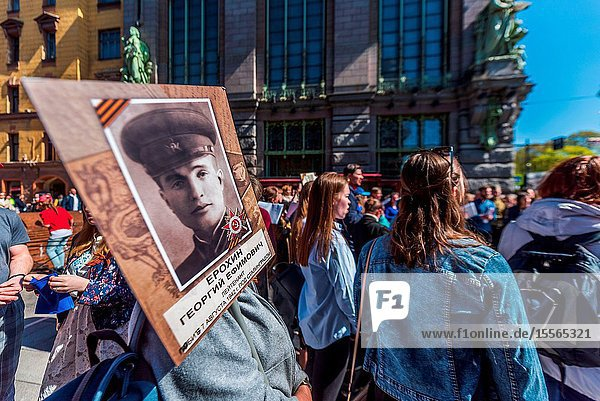 Immortal regiment - people carry banners with a photograph of their warrior ancestors  Victory Day  Nevsky Prospect  St. Petersburg  Russia