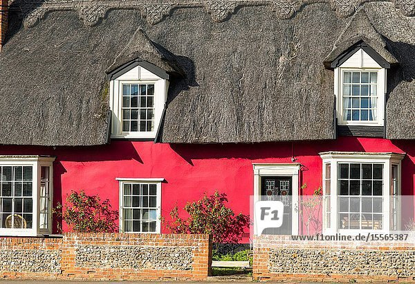 Picturesque red thatched cottage at Cavendish village in Suffolk  East Anglia  England  UK.