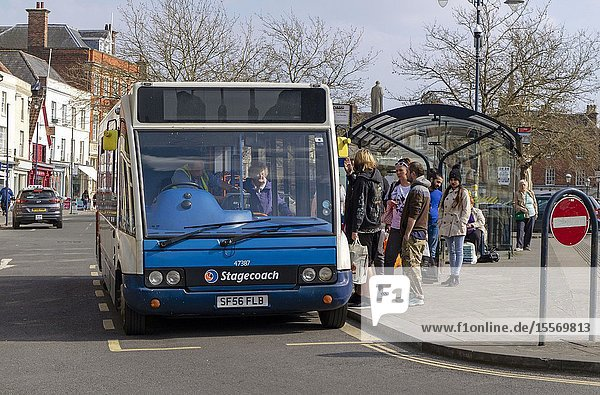 Devizes  Wiltshire  England  UK. March 2019. Passengers boarding a town service single deck bus in this old histroic market town.