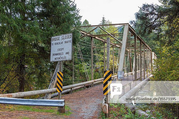 A steel arch bridge  no longer strong enough to support vehicles  receives new life as a crossing for people and lighter machines.