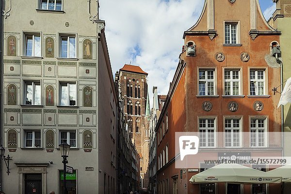 Narrow street in Gdansk old town  Poland. St Mary's basilica tower in the distance.