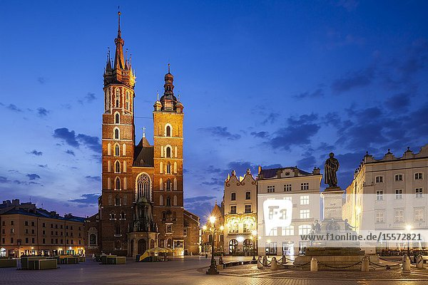 Dawn at St Mary's basilica on the main market Square in Krakow old town  Poland.