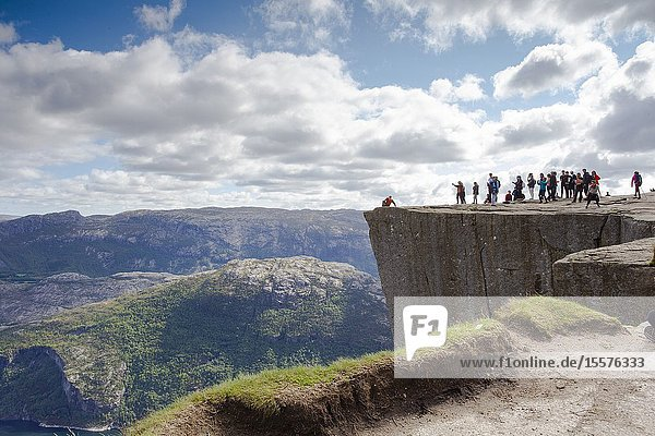 Preikestolen or Prekestolen. Pulpit Rock  famous attraction near Stavanger. View on Lysefjord  Norway traveling and hiking.