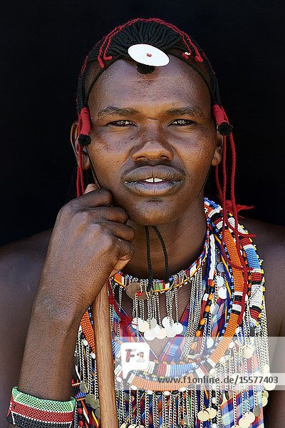 Masai man adorned with traditional bead work and colour glass perls around his neck. Masai Mara National Reserve  Kenya.