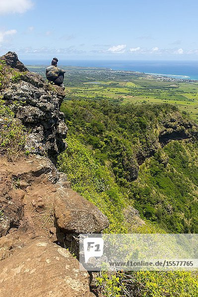 Hiker on the Sleeping Giant  also known as Nounou Mountain  a mountain ridge located west of the towns Wailua and Kapaa in the Nounou Forest Reserve on the Hawaiian Island of Kauai  Hawaii  USA.