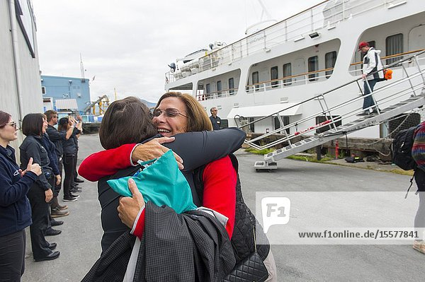 Passengers of the cruise ship Safari Endeavour saying goodbye to the crew at disembarkation in Juneau  Alaska  USA.
