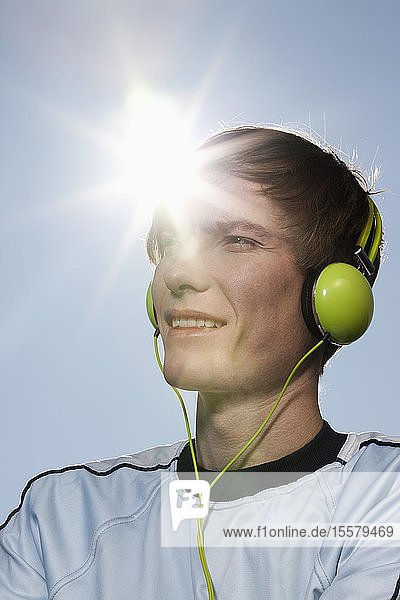 Germany  Bavaria  Munich  Young man listening to music