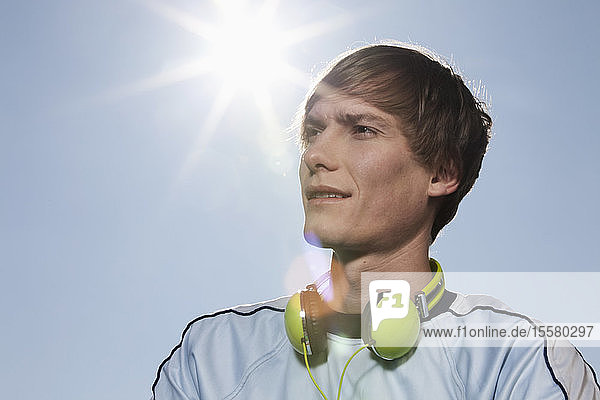 Germany  Bavaria  Munich  Young man with head phones