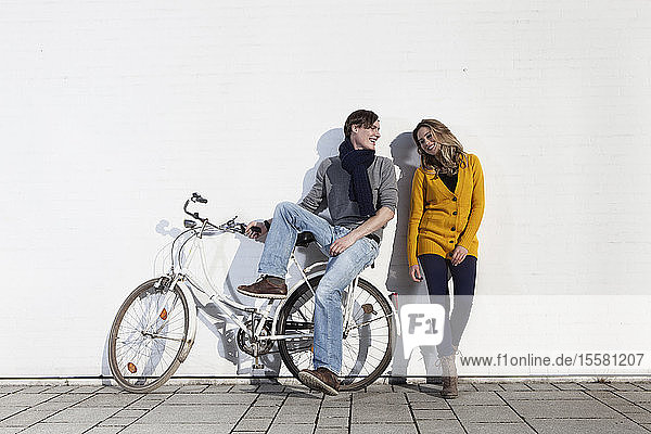 Germany  Bavaria  Munich  Young couple with with bike  smiling
