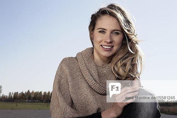 Germany  Bavaria  Munich  Young woman smiling  portrait