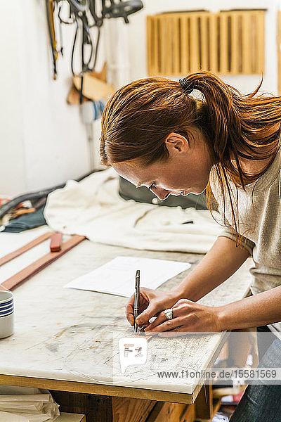 Woman cutting elastic fabric rubber band for radio collar