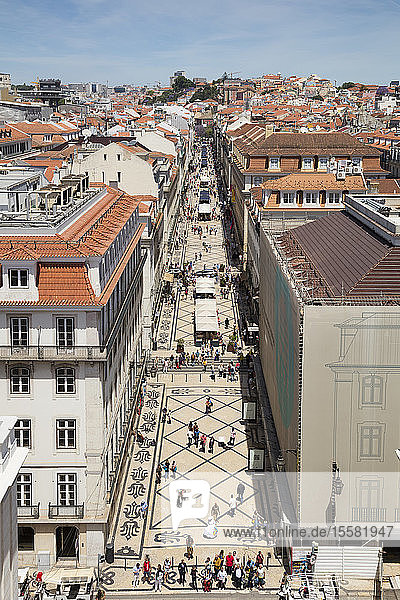 Pedestrians on street seen from Arc de Triomphe  Lisbon  Portugal