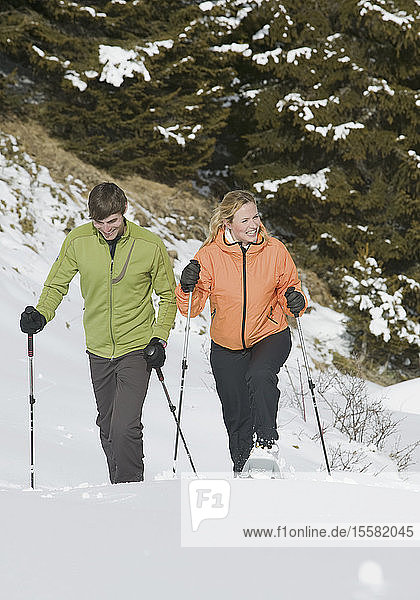 Germany  Bavaria  Young couple snowshoeing