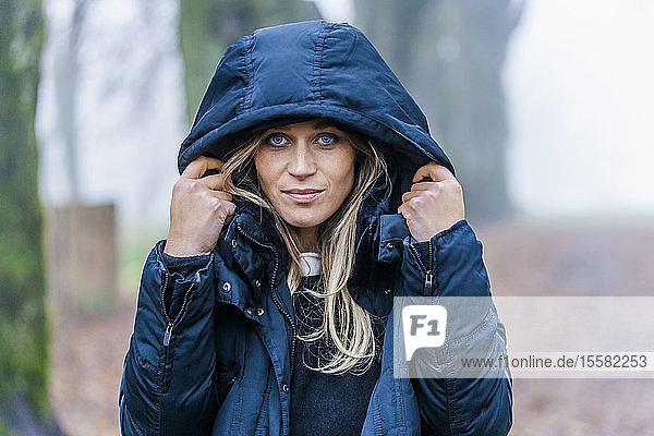 Portrait of blond woman wearing blue anorak