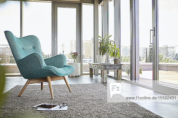 Home interior with armchair  tablet and view on roof terrace