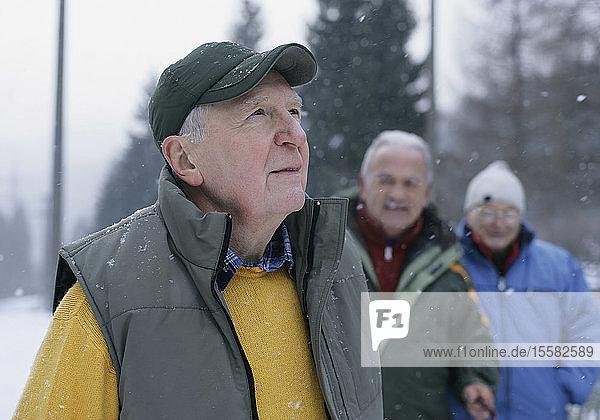Germany  Senior men standing in winter