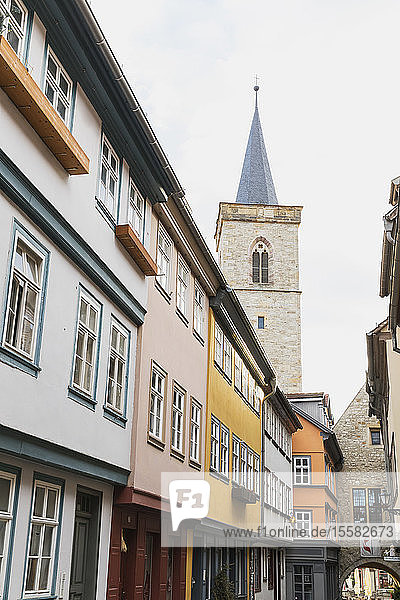 Low angle view of residential buildings and church against sky in Erfurt  Germany