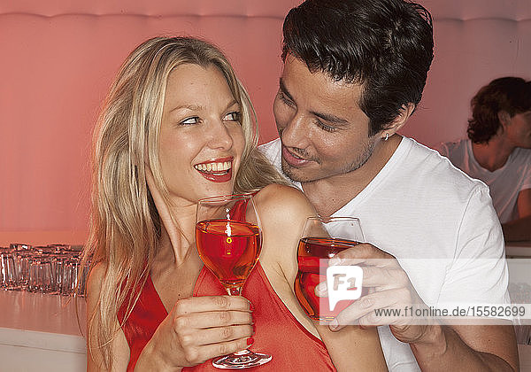 Germany  Stuttgart  Couple in nightclub with cocktails  smiling