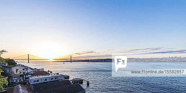 April 25th Bridge over Tagus river seen from Cacilhas during sunset  Lisbon  Portugal