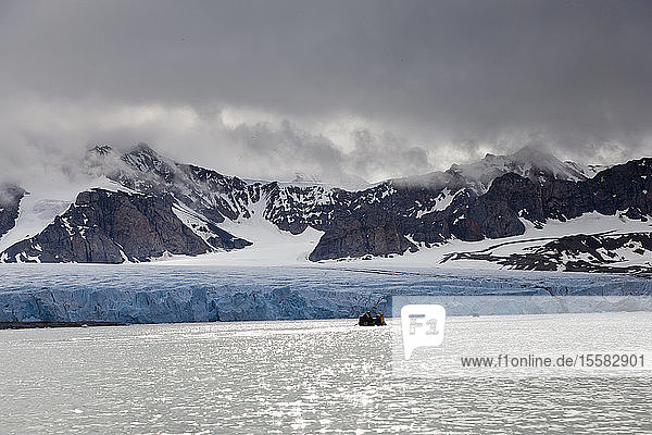 Europe  Norway  Spitsbergen  Svalbard  View of zodiac boat in water near glacier