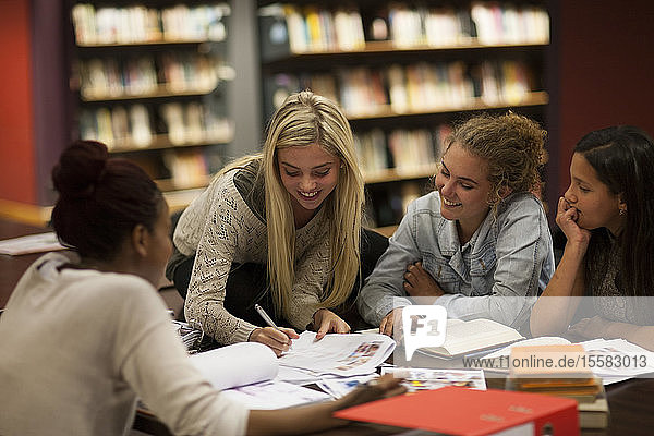 Group of female students learning in a library