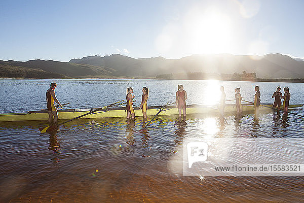 Female's rowing eight in water