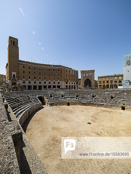 Roman amphitheater against clear blue sky in Altstadt during sunny day  Lecce  Italy