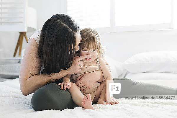 Woman touching her daughter's nose