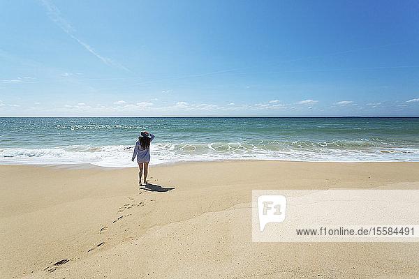 Woman walking on beach in Lisbon  Portugal