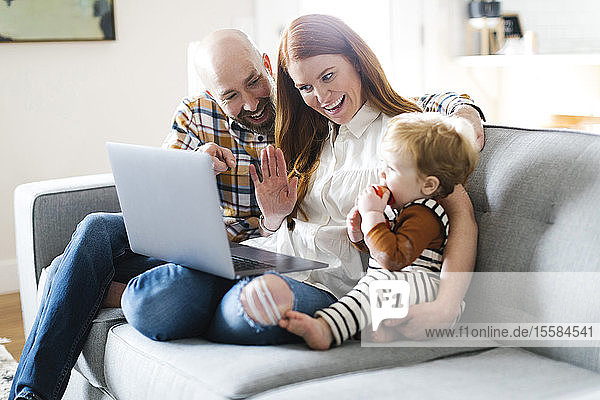 Family using laptop to video chat