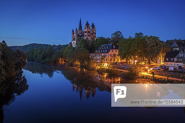 Limburg Cathedral by river at night in Limburg  Germany