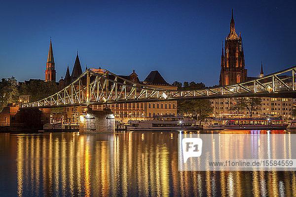 Bridge over river at sunset in Frankfurt  Germany