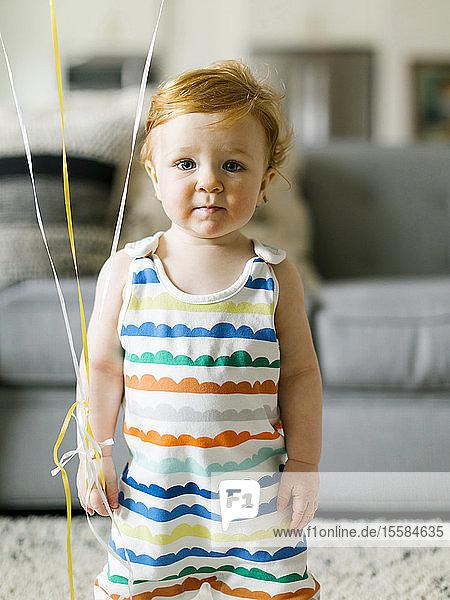Baby boy wearing striped romper
