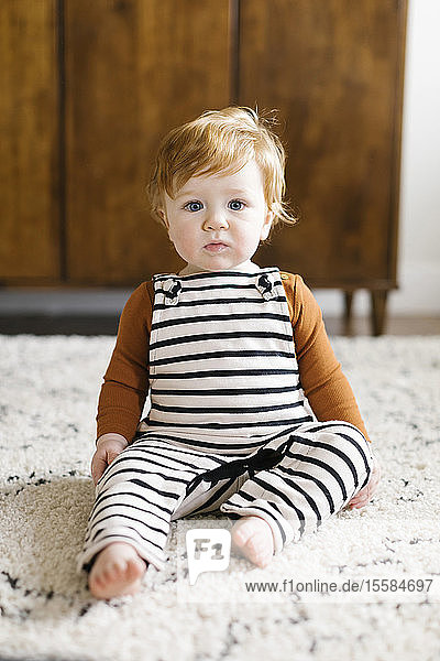Baby boy wearing striped overalls